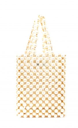 Hand-woven bag using off-white and golden pearls, on top of an acrylic box.